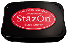 Buy a black StazOn stamp pad, which features a permanent, quick-drying ink designed for non-porous surfaces.