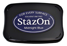 Buy a midnight blue StazOn stamp pad, which features a permanent, quick-drying ink designed for non-porous surfaces.