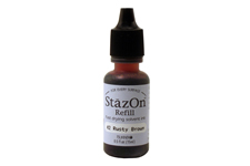 Buy a 1/2 oz. bottle of quick-drying, solvent-based refill ink for a rusty brown StazOn stamp pad.