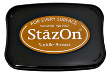 Buy a saddle StazOn stamp pad, which features a permanent, quick-drying ink designed for non-porous surfaces.